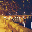 seine river with pont notre dame and pont au change in paris at night — Stock Photo