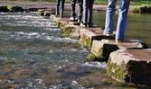Crossing stepping stones in a river — Stock Photo