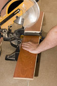 Carpenter cutting wood floor — Stock Photo