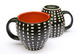 Two dotted coffee mugs — 图库照片