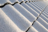 Snowy roof perspective — Stock Photo