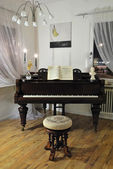 Grand piano in corner — Stock Photo