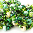 Green and yellow glass beads — Stockfoto