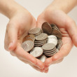 Silver coins in hands — Stock Photo