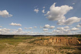 A landscape of plains, rocks and clouds — Stock Photo