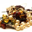 Amber and pearl jewellery — Stock Photo