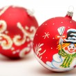 Red christmas balls with drawing — Stock Photo