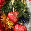 Christmas hearts hanging on fir branch — Foto Stock