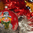 Christmas ball with drawing of snowman — Stockfoto