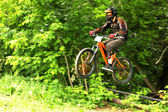 Mountain biker in flight — Stock Photo