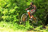 Mountain biker in flight — Stock Photo