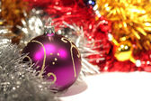 Purple christmas ball with gold pattern — Stock Photo