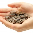 Silver coins in hands isolated on white — Stock Photo