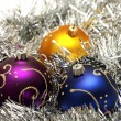 Christmas balls on silver tinsel — Stok fotoğraf