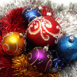 Christmas balls on tinsel background — Stock Photo