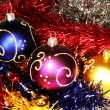 Christmas balls on tinsel background — Stock Photo #2547423