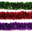 Green, red and purple tinsel — Stock Photo