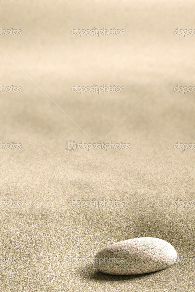 Close up of a small rock on a background of sand — Stock Photo #2221826