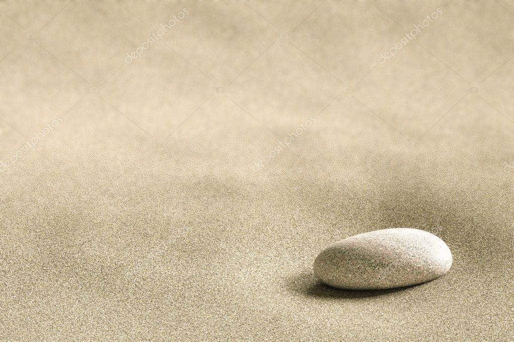 Close up of a small rock on a background of sand — Stock Photo #2295436