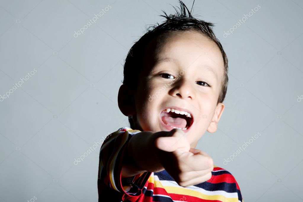 Child looking at camera with positive attitude. Smiling — Stock Photo #2447029