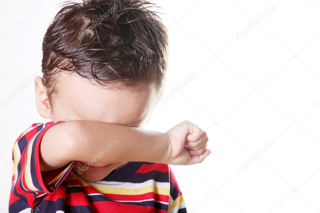 Child crying covering his face with his hand.   Stock Photo #2447264