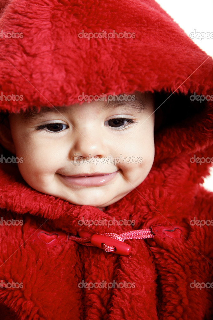 Looking down, baby with red hood over white background — Stock Photo #2543347