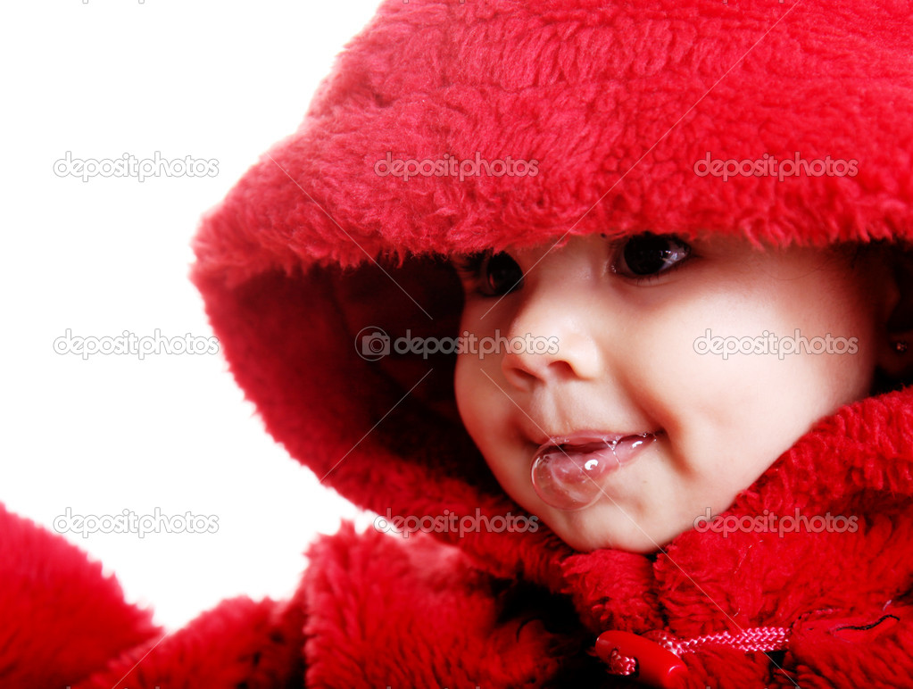 Beautiful baby with red hood over white background — Stock Photo #2543354