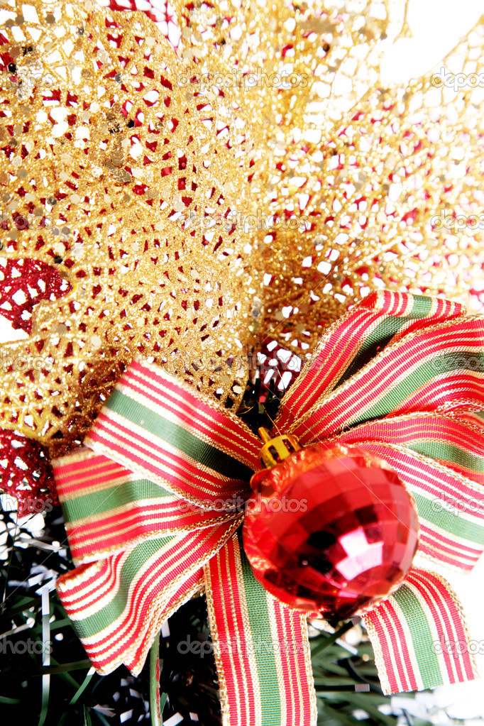Christmas decorations. A gold leaf with a red bow — Stock Photo #2543533