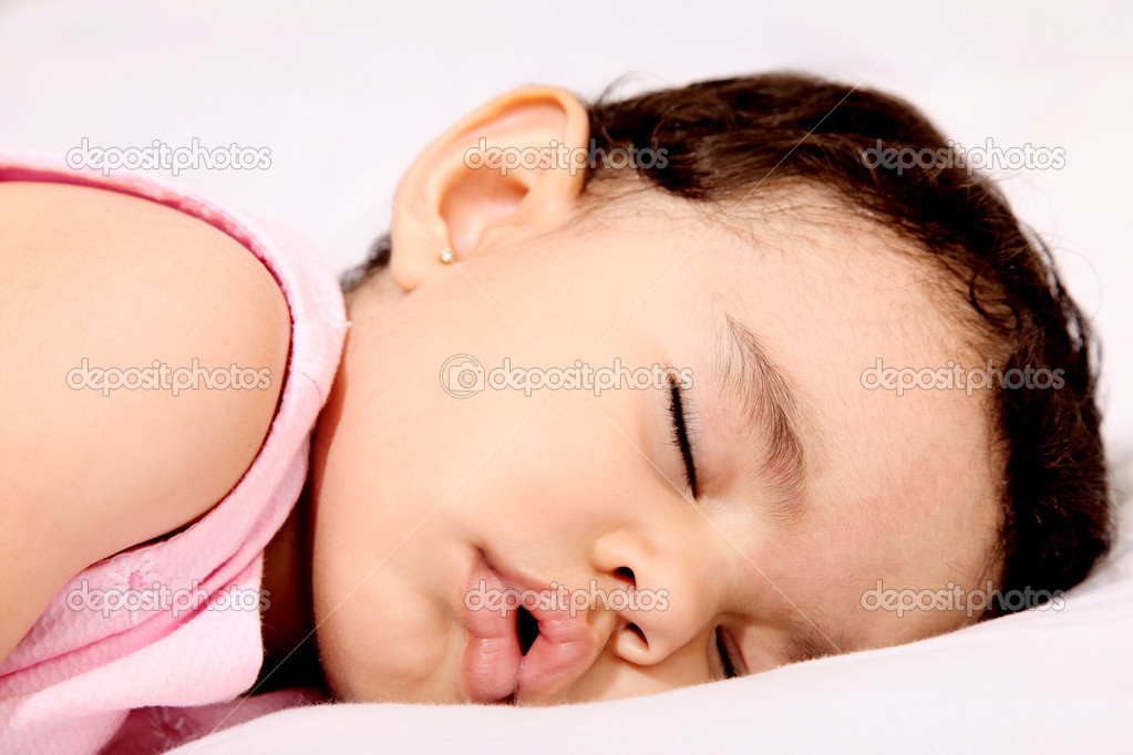 Beauty baby sleeping on white pillow. Serene scene — Stock Photo #2544169