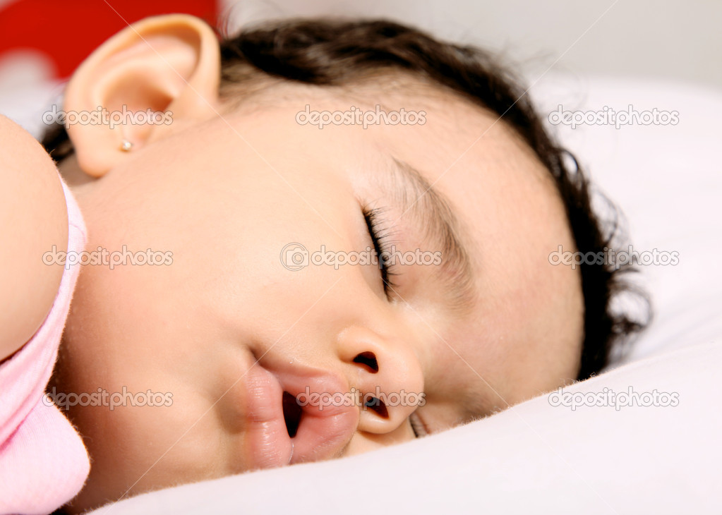 Cute baby sleeping on a white pillow  Stock Photo #2544186