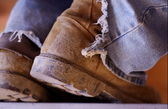 Construction Boots and Old Jeans — Stock Photo