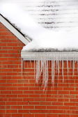 Icicles on House — Stock Photo