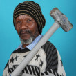 Stock Photo: African Man and Hammer