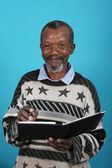 African Man and Book — Stock Photo