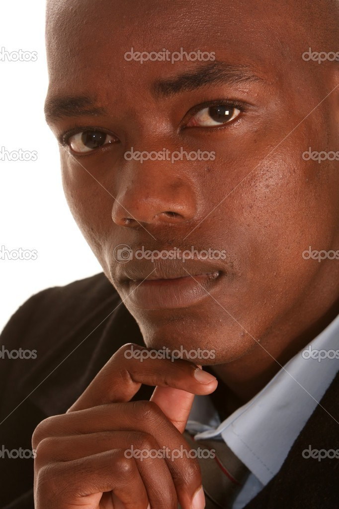 Portrait of a handsome African businessman with hand on chin — Stock Photo #2291439