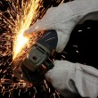 Industrial Grinding Orange Sparks - Stock Photo