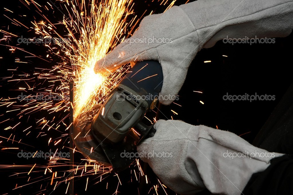 Shower of orange sparks from a worker grinding steel — Stock Photo #2320929
