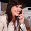 Pretty Brunette Receptionist - Stock Photo