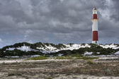 Lighthouse with dark clouds — Stock Photo