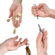 Stock Photo: Five different keys in womhands
