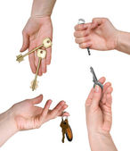 Five different keys in woman hands — Stock Photo