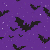 Halloween bats seamless background — Stock Vector