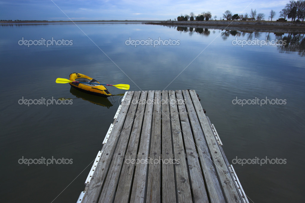 Kayak on the lake attached to a wooden pier — Stock Photo #2272441