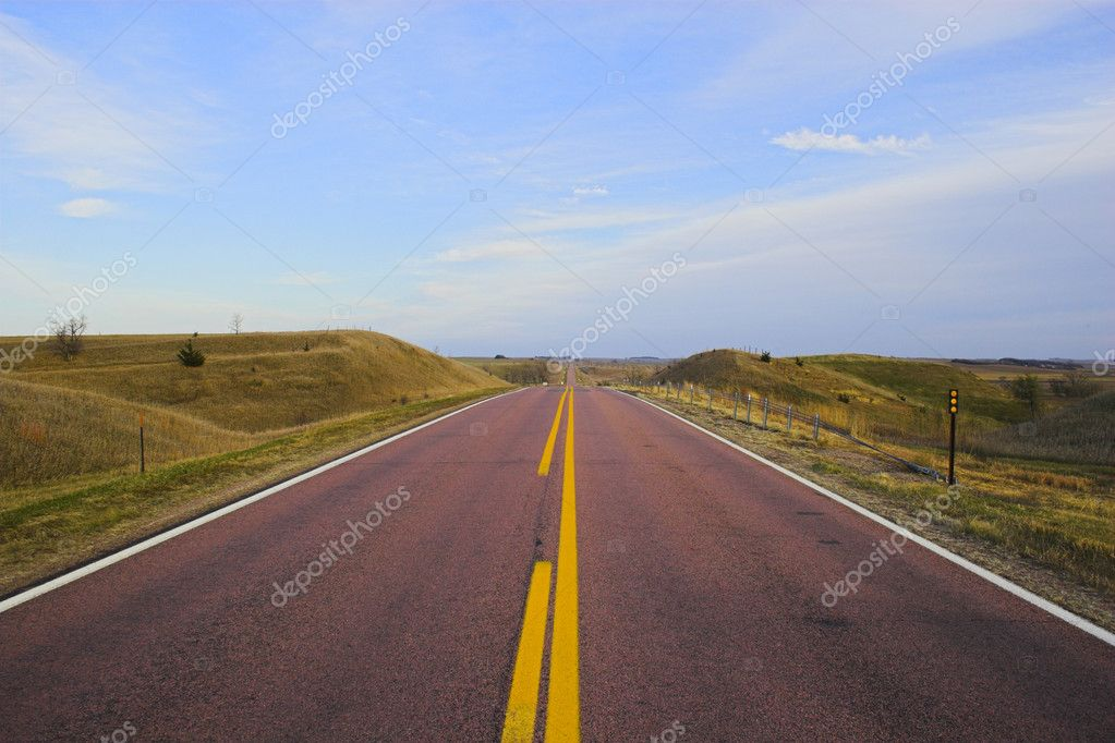 Roads in countryside surrounded by colorful fields and meadows — Stock Photo #2275892