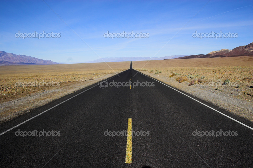 Desert road going through mineral deposits and geological formations of Death Valley National Park — Stock Photo #2367590