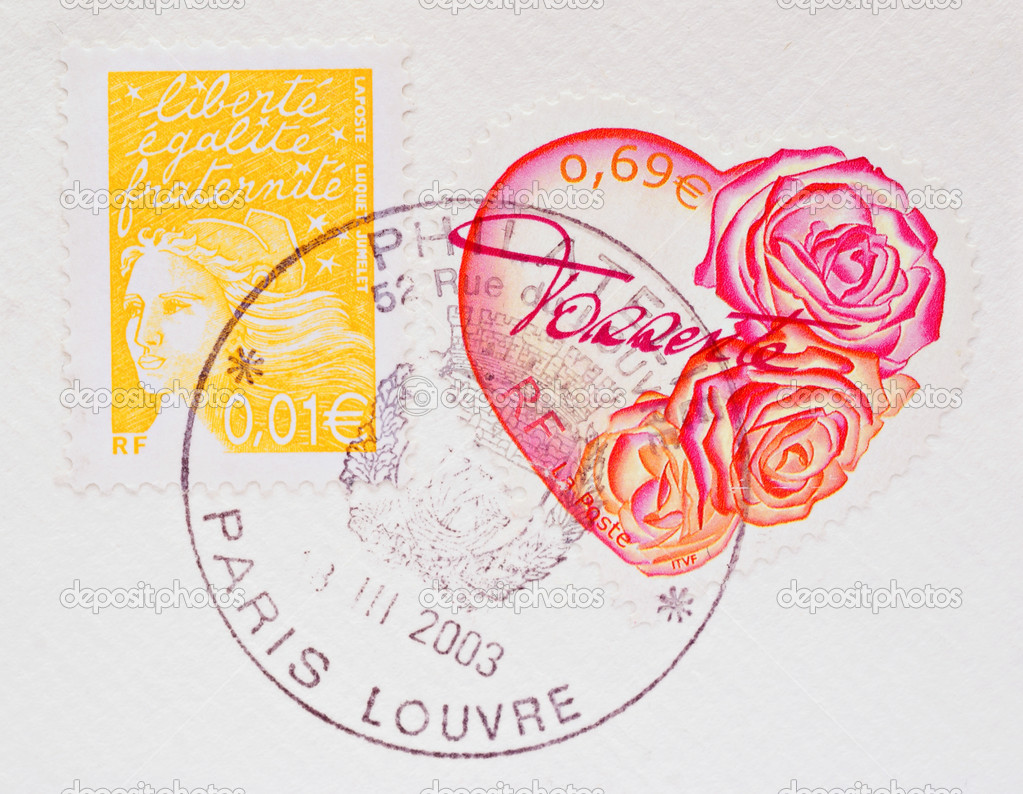 Heart Shaped French Postage Stamp showing pink and red roses on a white envelope, with another stamp and Paris postmark, circa 2003 — Stock Photo #2272388