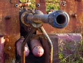 Fragment of an old gun. — Stock Photo