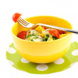 Vegetable salad in a yellow bowl - Stock Photo