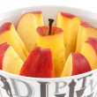 Chopped red apple on a dish. closeup — Stock Photo