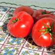 Red fresh tomatoes on a kitchen towel — Stock Photo #2282179